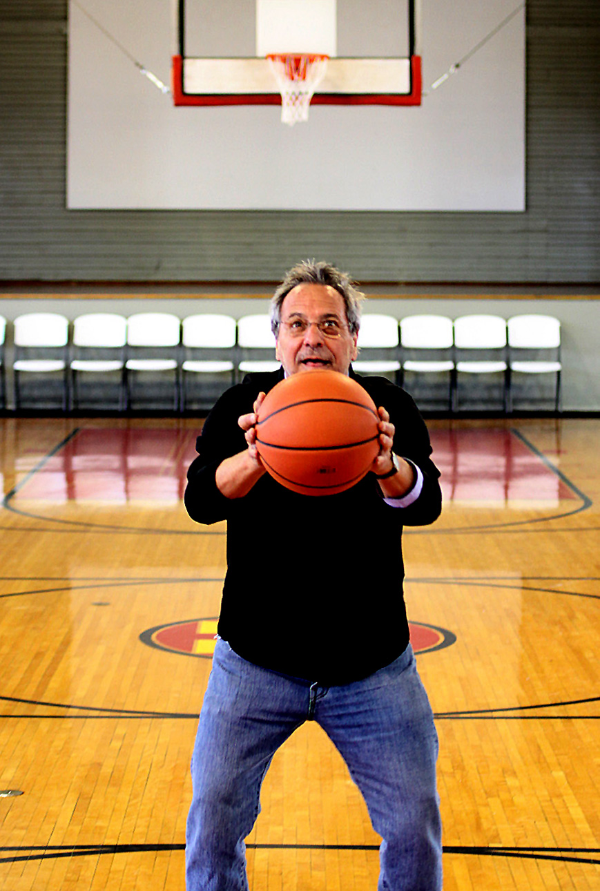 """Hoosiers Director David Anspaugh tries an """"Ollie"""" free throw at the Hoosier Gym in Knightstown. The century-old gymnasium, once home to the Knightstown High School Panthers, served as Hickory Huskers' home court in the beloved 1986 film. Anspaugh and a small entourage stopped by the Hoosier Gym in March 2013."""