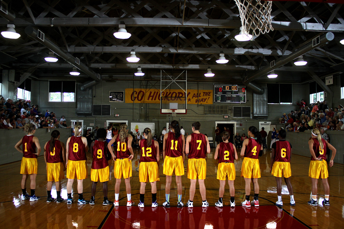 """The Lady Hickory Huskers line up for introductions prior to the 2012 game. Some have described their visits to the Hoosier Gym as """"stepping into a time machine."""" Indeed, this photographer has witnessed grown men cry upon entering what, to them, must be a very special place."""