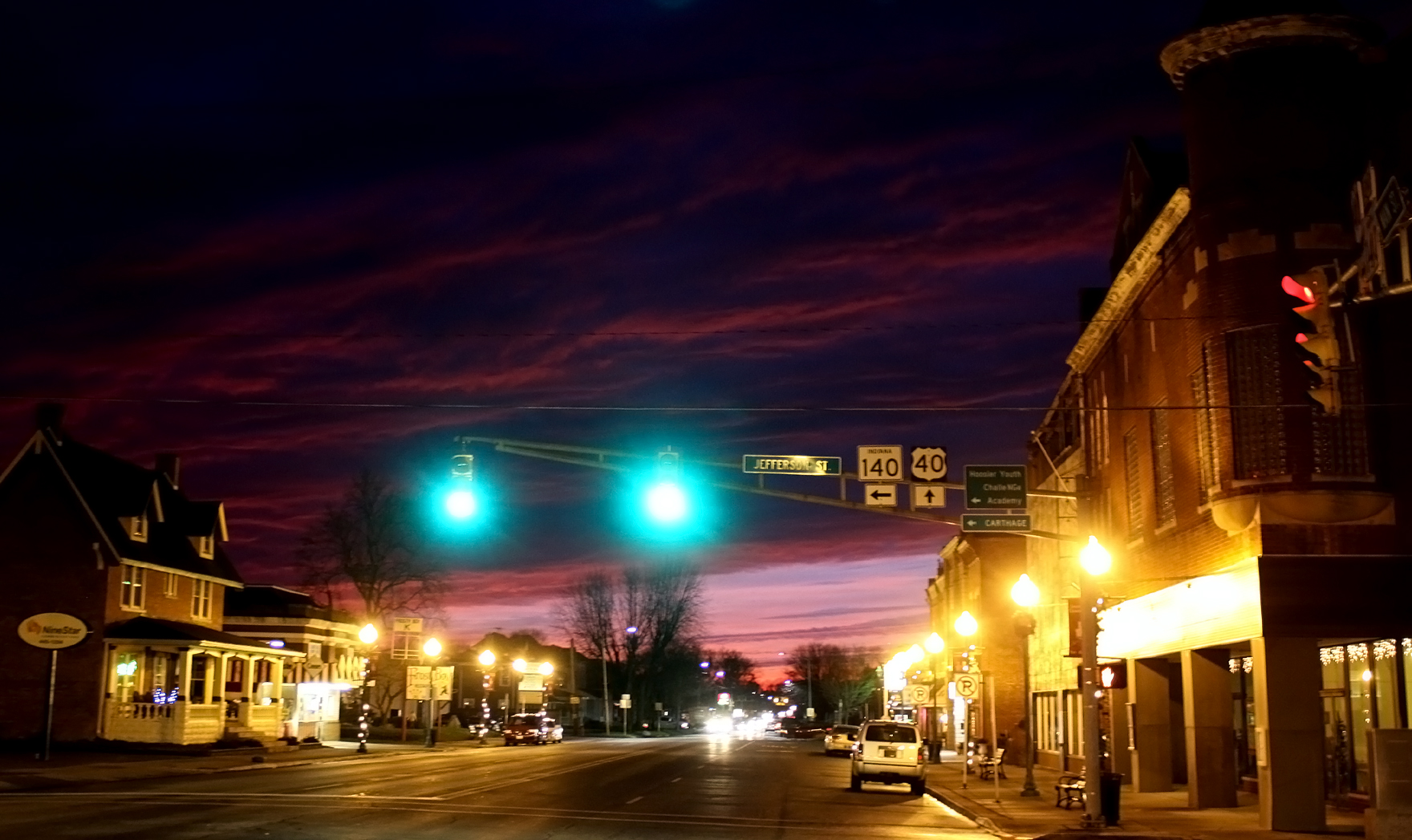 A dazzling sunset coupled with Knightstown's street and stoplights make an interesting image. The bucolic nature of small bergs like Knightstown is what drives many people from the city into the arms of such small towns. Residents find peace and a slower pace here. Traffic jams are practically nonexistent - except when back-ups on I-70 force cars and semis down onto U.S. 40. But, even then the waits are mercifully short compared to Indy's recurrent drive-time gridlock.