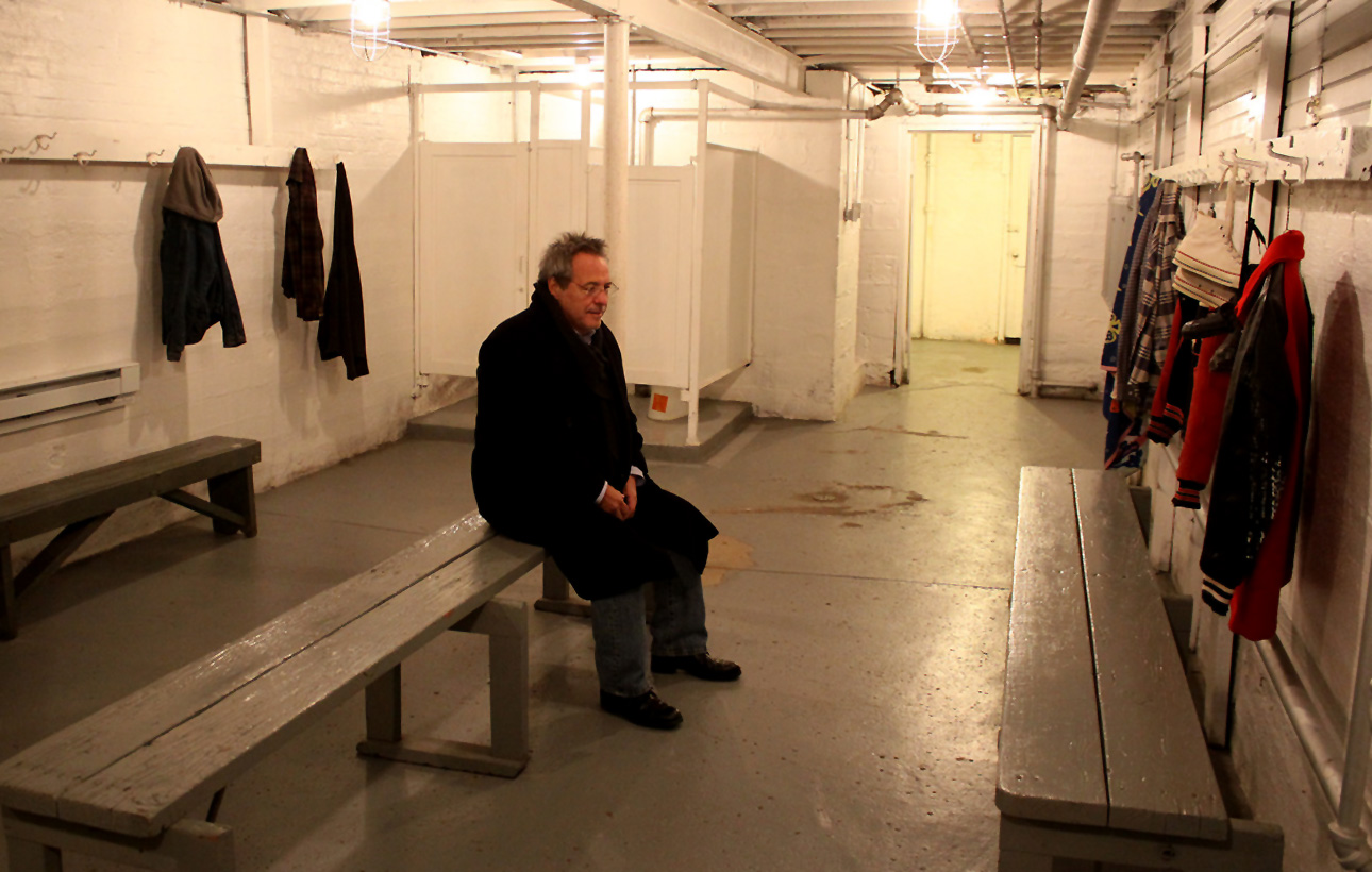 """Moments after I snapped this photo, Hoosiers Director David Anspaugh asked if he could have a moment alone in the Hoosier Gym's basement locker room, where Coach Normal Dale (Gene Hackman) showed his players how to run the """"Picket Fence."""" Pensive throughout his March 2013 visit to the gym, Anspaugh nevertheless cheerfully signed autographs and shared production stories with visiting fans of the movie and Hoosier Gym staff."""