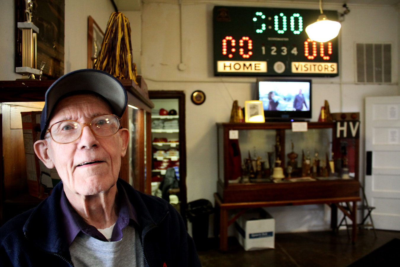 Knightstown native Bill Sitler is one of the few remaining citizens who actually played ball in the gym as a high school student. Sitler has been an active Hoosier Gym volunteer for decades, having served as treasurer, tour guide and general goodwill ambassador. Present when Hoosiers Director David Anspaugh visited, Sitler told him how he'd played ball in the gym as a youngster. That brief story was enough to move Anspaugh to tears, overcome apparently by the nostalgia. Here, Sitler is show in the Hoosier Gym foyer.