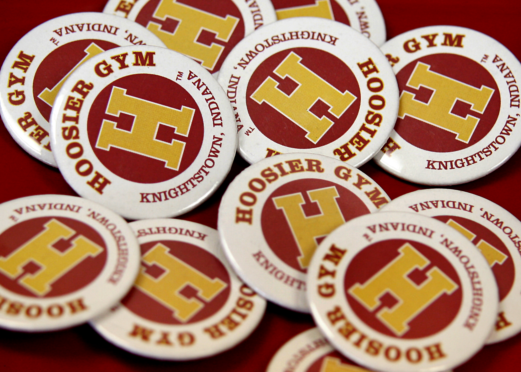"Hoosier Gym souvenirs are always on sale, and proceeds benefit the historic structure. T-shirts, DVD copies of the film, posters, pencils and other items can always be purchased on a visit to the gym. Among the favorites are buttons like these and Jimmy Chitwood T-shirts emblazoned with the words, ""I'll make it."""