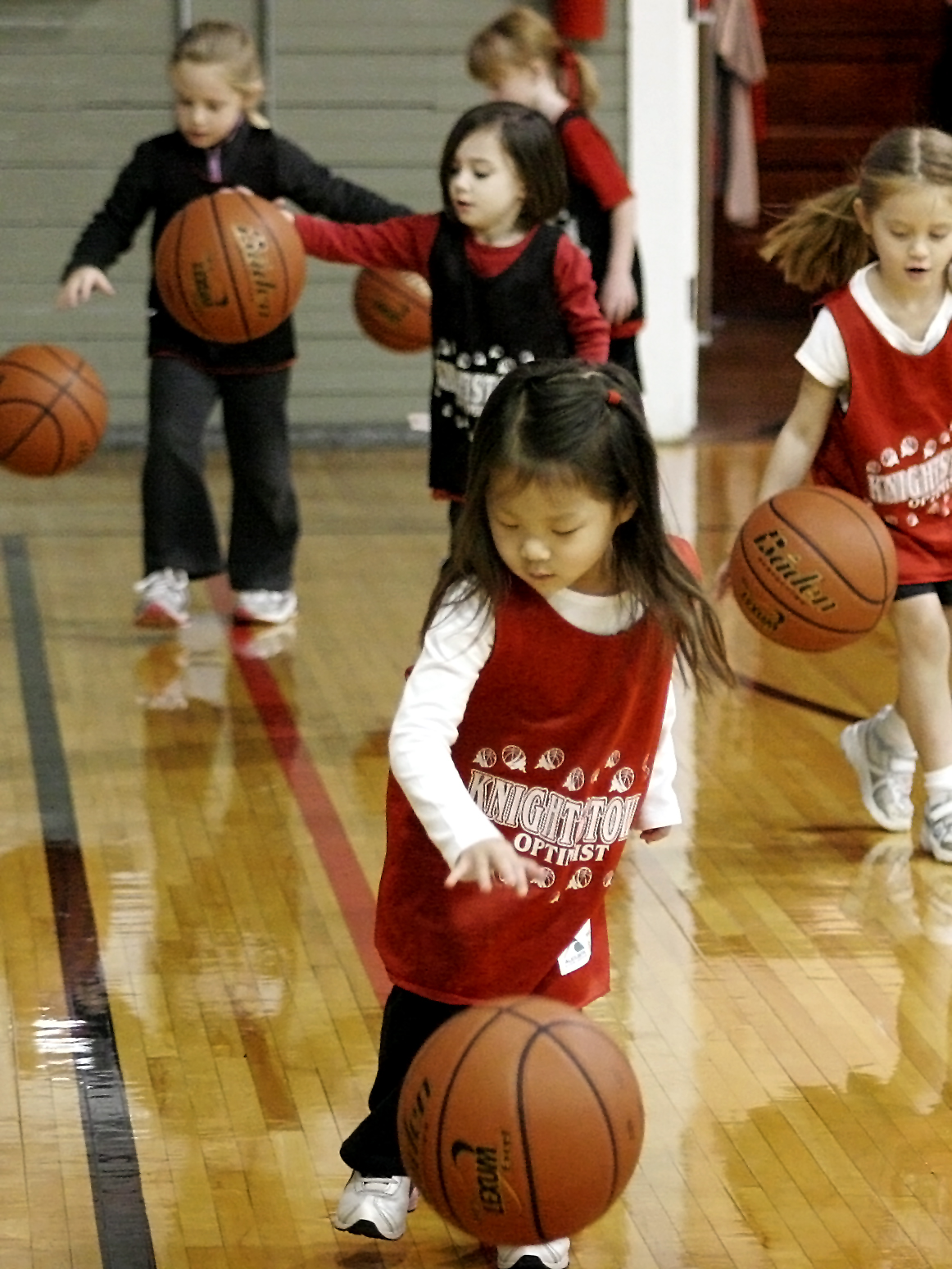 Little kids learning the fundamentals of basketball just seems so right in a place like the Hoosier Gym. Here, Optimist Club youngsters practice their dribbling skills. Feelings of Hoosier pride swell up for most people when they enter the gym - even for non-Hoosiers!