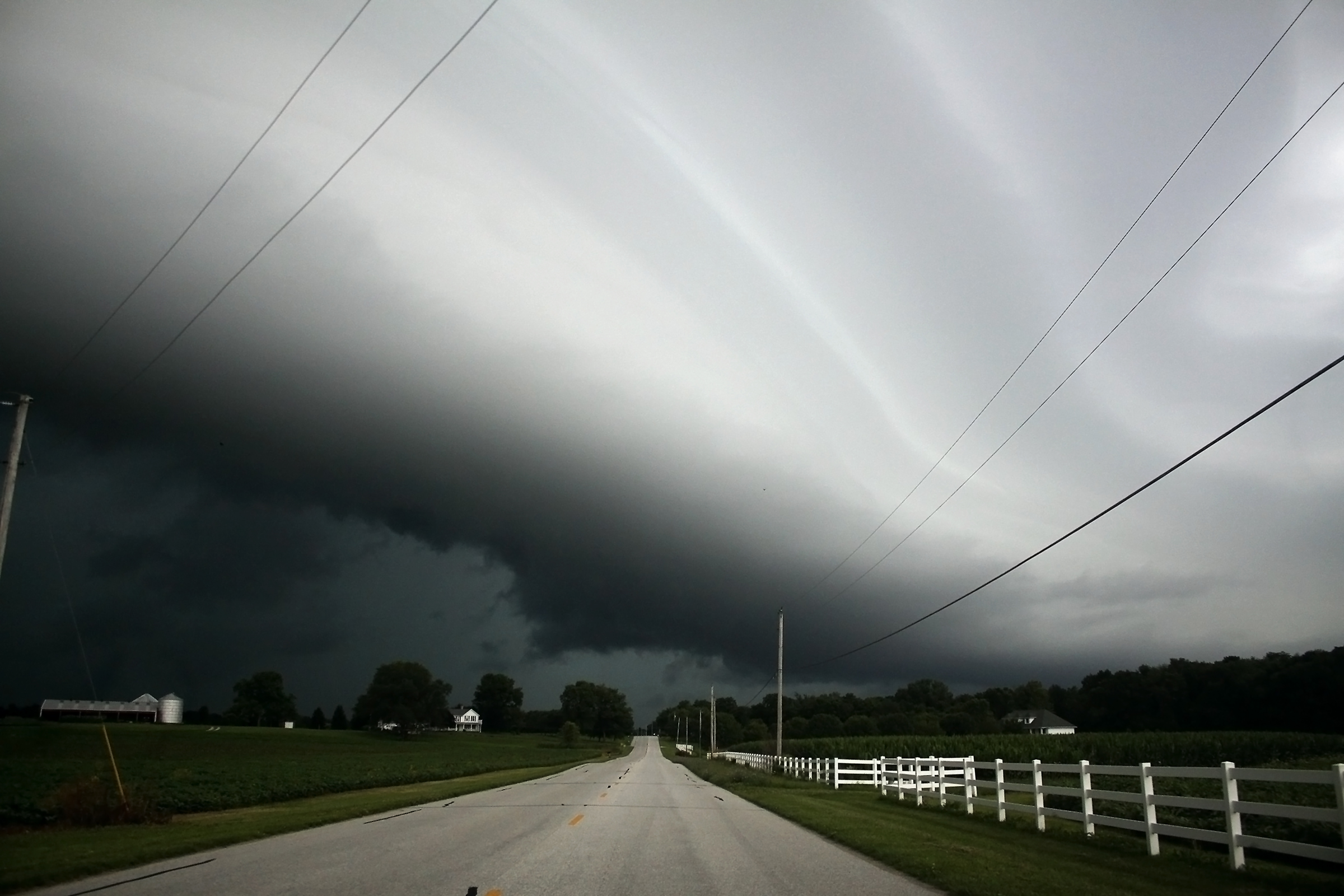 A massive shelf clouds rolls across Henry County, ushering in late summer thunderstorms. The darker clouds, which can be seen below the main cloud, occasionally threatened to swirl into funnel clouds, but eventually dissipated.