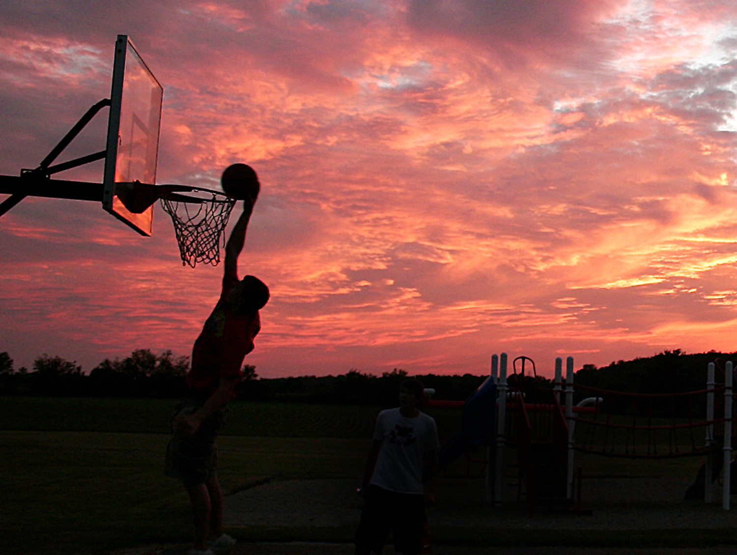 A typical Indiana scene plays out at Kennard Elementary School as local kids test their skills on the playground basketball court. The striking sunset makes a nice backdrop for this scene, which could've been cut from the popular movie Hoosiers itself.