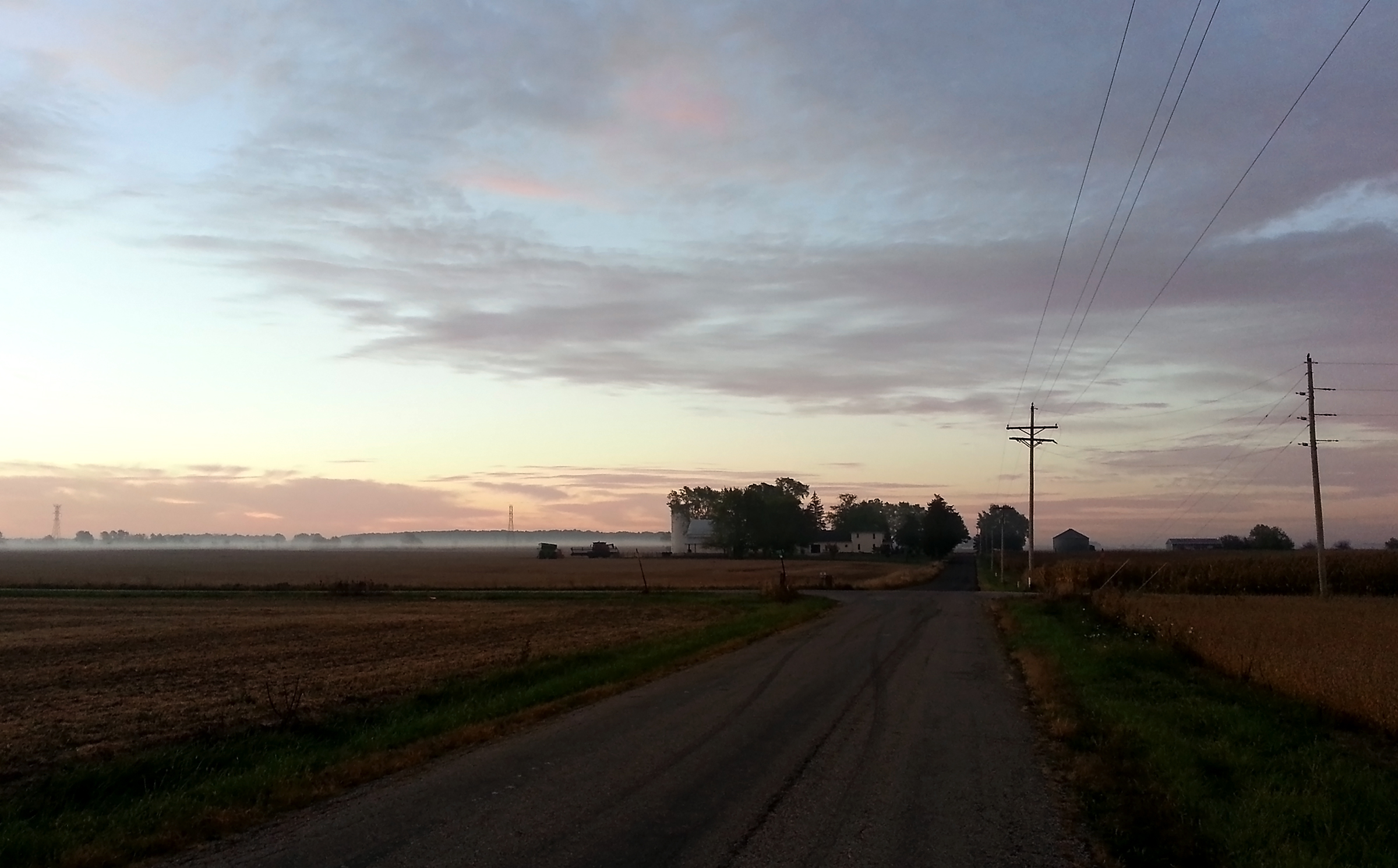 A thin layer of mist hangs over farm fields in central Henry County on a typical summer morning in 2015. Like in your neck of the woods, sunrise is a tranquil time here - a quiet time, before the world opens its noisy mouth.