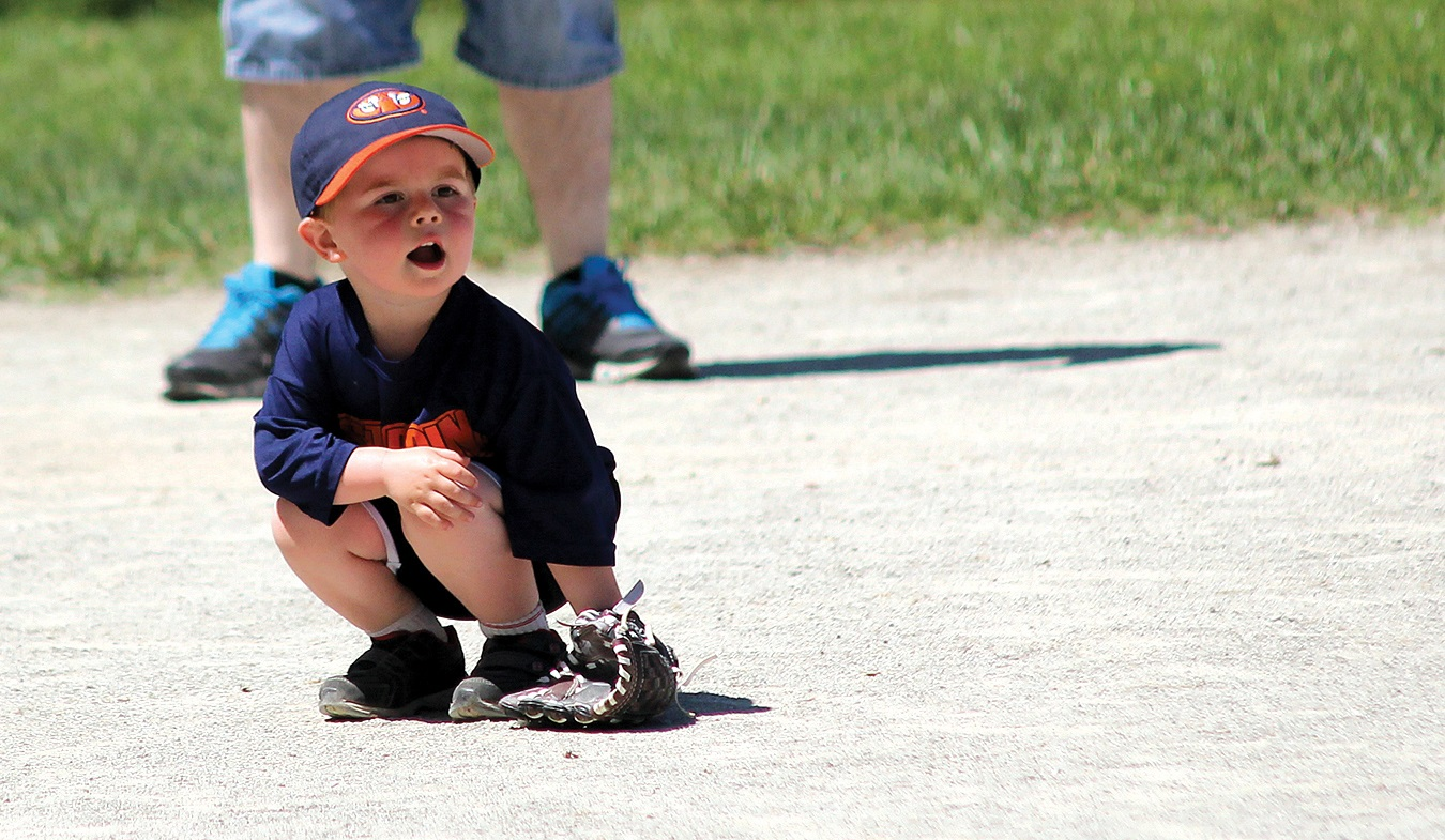 Organized chaos is how one parent described a baseball game among four- and five-year-olds in Knightstown. At this level, game rules are often eschewed so the kids can just get the hang of hitting, fielding and running the bases. Waiting for a hit, however, can be boring, as this young infielder discovered.