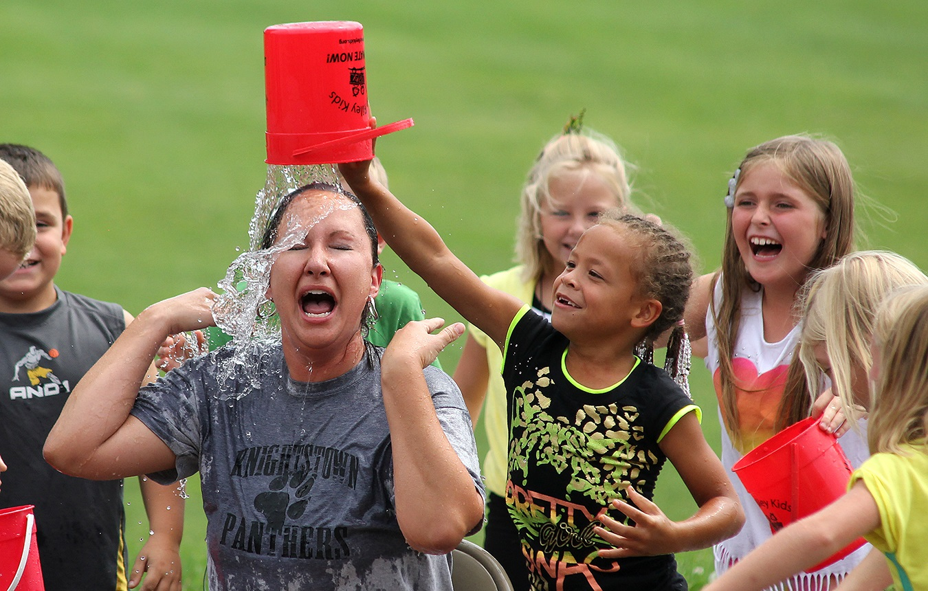 The Ice Bucket Challenge was a huge fad a few years back. Knightstown Elementary School Prinicipal Danielle Carmichael took the opportunity to raise funds for a student project. To the delight of her young students, Carmichael graciously and humorously allowed them to dump buckets of water over her and other teachers' and staff's heads.