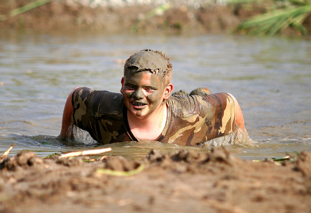 What could be better for a young country boy than a mud pit made specifically for the purpose of doing belly flops? Not much, according to Jackson Lukens of Knightstown, shown here emerging from the chocolate pudding-like depths of a mud pit.