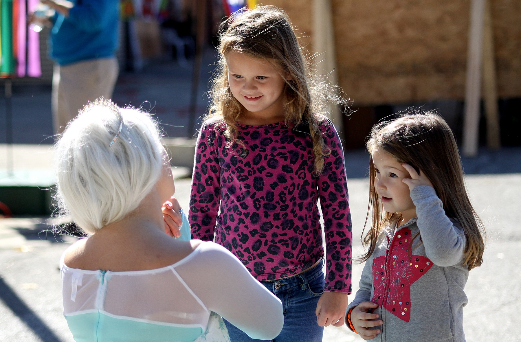 A look of wonder passes over the faces of two young ladies meeting the heroine of the hit children's movie Frozen.