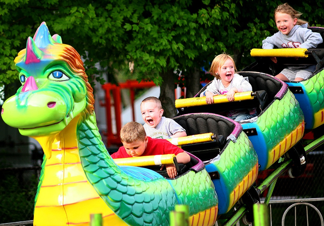 Knightstown's Jubilee Days event features a carnival with rides and games for the kids. Posting up beside a kiddy rollercoaster, I found it easy to get good shots of children experiencing their first rides.