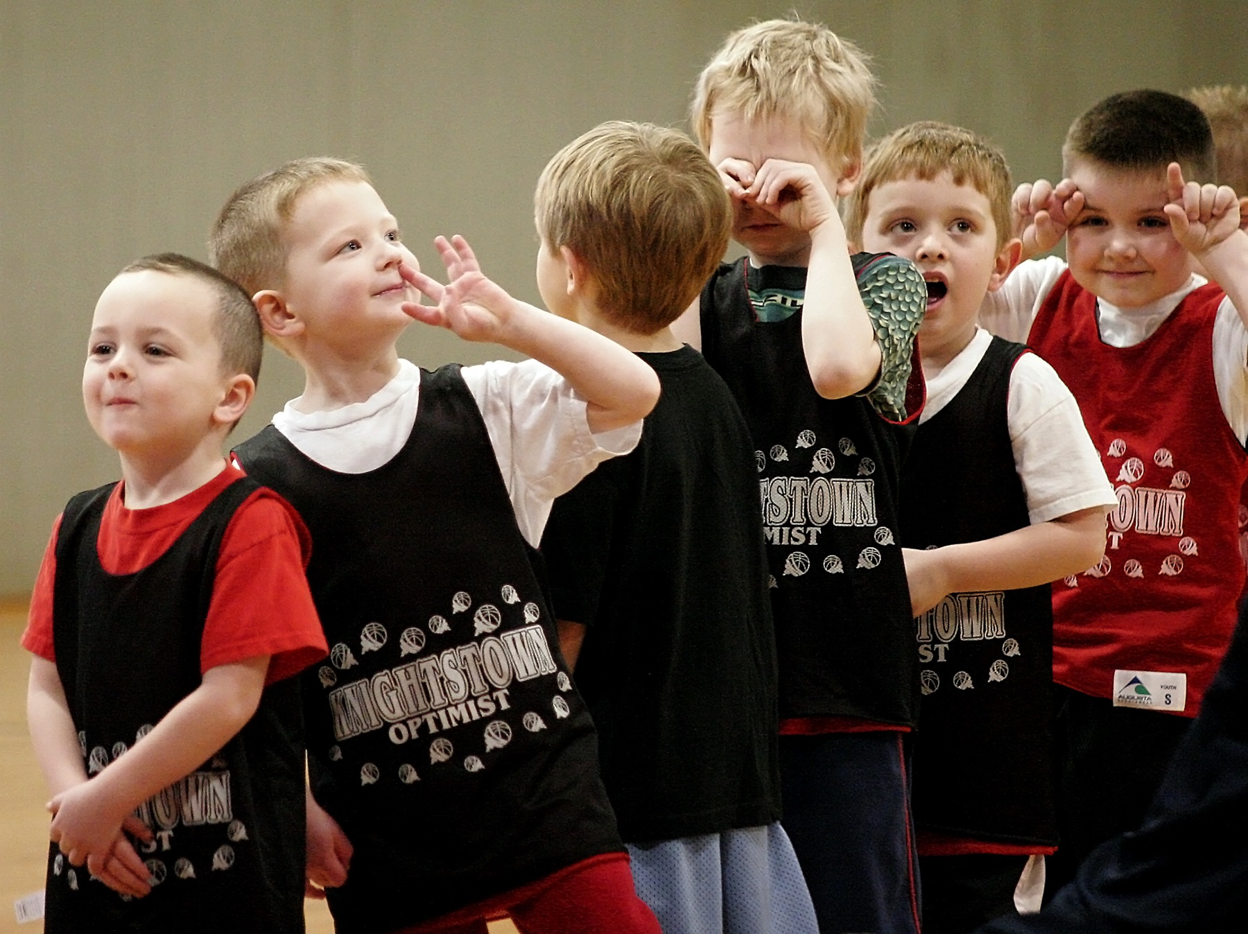 Put 10 little boys in a line and make them wait to shoot free throws. Then, sit at a distance with a telephoto lens and watch the hilarity as they bide their time waiting their turns. Ten different kids equates to 10 different ways of doing that.