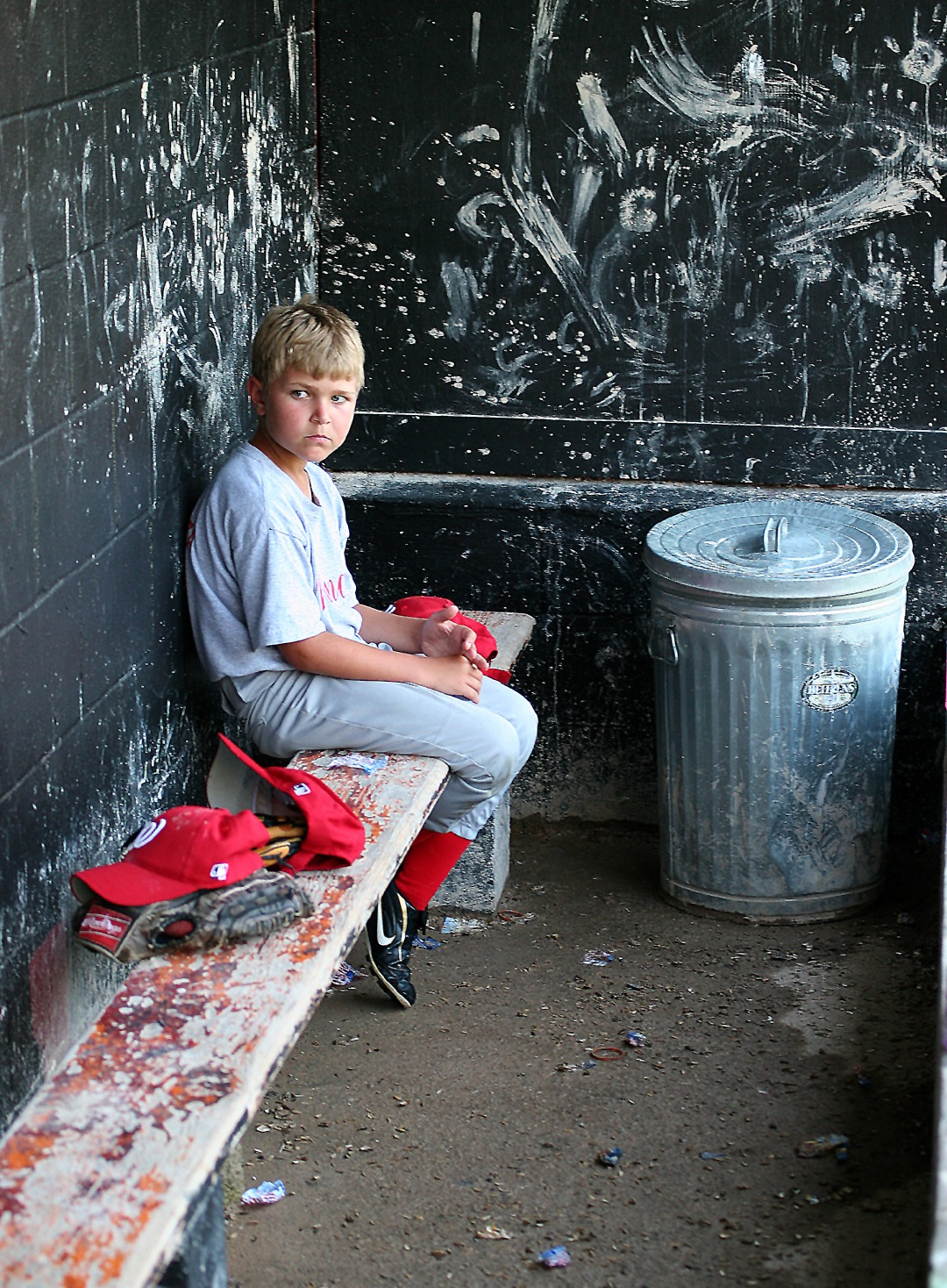 """""""Put me in, coach!"""" The words from the John Fogarty songs Centerfield always come to mind when I see this photo of a young player waiting his turn to get in the game. Left in the dugout while his team battles for a win, this kid waited patiently and cheered his teammates on, in spite of his not playing at that moment."""