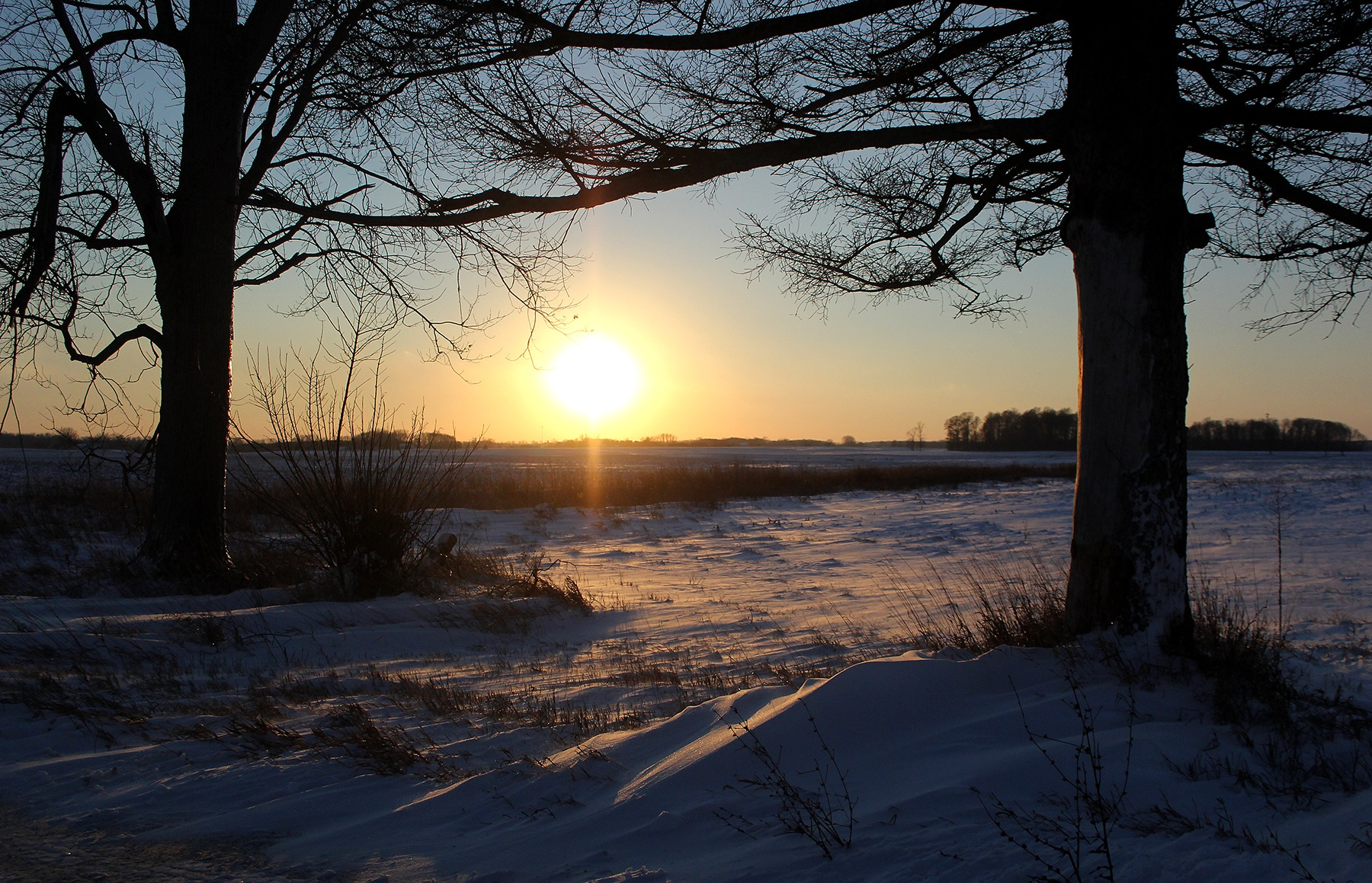 Sunset on a snowy day in Henry County, Indiana.