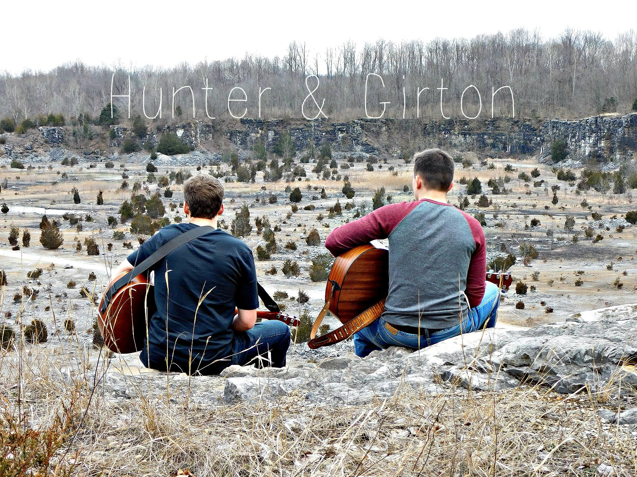 "Hunter: ""My guitar skills serve well enough to write something and get into the scene, but I'm really comfortable on stage doing much more than basic strumming. Girton: ""We balance each other out that way. He's a much better vocalist than I am, and the balance of skills sort of works out. Photo by Jennifer Lewis, courtesy of Hunter and Girton"